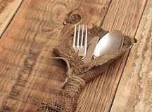 Spoon, knife and fork in rough old sacking Stock Photography