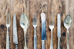 Spoon knife and fork on the wooden board. Stock Photo