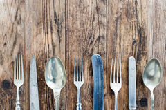 Spoon knife and fork on the wooden board. Stock Image