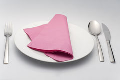 Spoon knife holder on white plate violet napkin Stock Photography