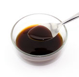 Spoon lap oyster sauce. On white background Stock Photos