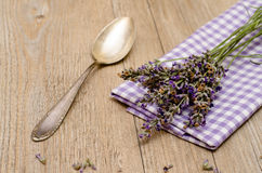 Spoon and lavender on a wooden table Royalty Free Stock Image