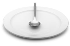 Spoon lie on a plate Stock Photos
