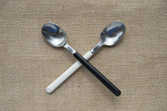 2 spoon on linen background Royalty Free Stock Photos