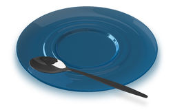 Spoon lying on blue saucer Royalty Free Stock Photo