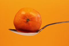 Spoon with Mandarin Stock Images