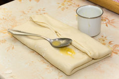 Spoon with margarine on the dough.  Stock Photos