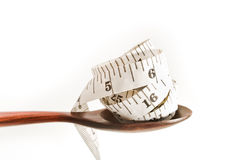 Spoon and measuring tape Stock Photos