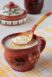 Spoon of milk soup with noodles and cup Stock Image