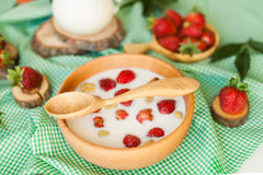 Spoon, milk and stawberries Royalty Free Stock Image