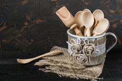 Spoon in a mug with handmade decor of burlap and lace Royalty Free Stock Photography