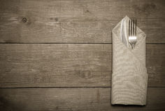 Spoon in napkin on wooden background. Toned Royalty Free Stock Photos