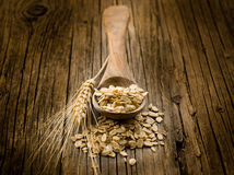 Spoon with oat Royalty Free Stock Photos