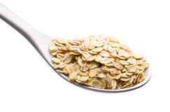 Spoon and oatmeal Stock Photography