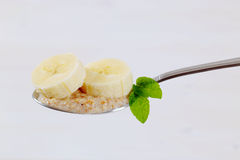 Spoon of oatmeal porridge with banana Royalty Free Stock Image