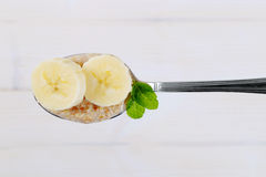 Spoon of oatmeal porridge with banana Stock Photography