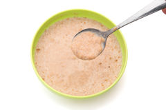 Spoon with oatmeal Royalty Free Stock Image