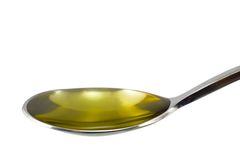 Spoon of olive oil Royalty Free Stock Images