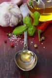 Spoon with Olive Oil and vegetables Stock Photo