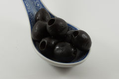 Spoon with olives. Spoon with black olives without stone Stock Image