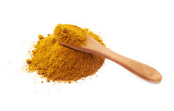 Spoon over the pile of curry powder Stock Photos