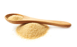 Spoon over pile of sugar Stock Photo