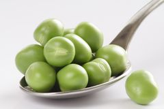 Spoon of Peas. Spoon of green peas - natural medicine Stock Images