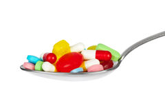 Spoon with pills Royalty Free Stock Images