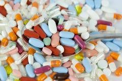 Spoon on pills Royalty Free Stock Photos