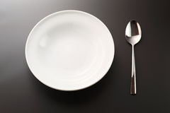 Spoon and  plate Stock Image