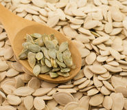 Spoon with pumpkin seeds Royalty Free Stock Photos
