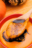 Spoon with pumpkin soup Stock Images