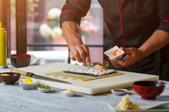 Spoon puts sauce on rice. Royalty Free Stock Image