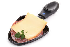 Spoon of raclette cheese Royalty Free Stock Image