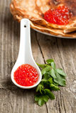 Spoon of red caviar Stock Photo