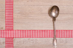 Spoon an red checkered ribbon Stock Photo