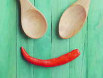 Spoon and Red chili peppers in smile Royalty Free Stock Images