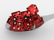 Spoon with red dices Royalty Free Stock Photos