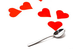 Spoon and red hearts isolated on white background. St. Valentine`sday Royalty Free Stock Photography