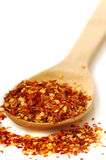 Spoon of red pepper flakes Royalty Free Stock Image
