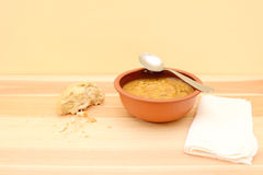 Spoon resting on a bowl of vegetable soup Stock Image