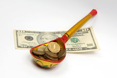 Spoon rubles and dollars Royalty Free Stock Photos