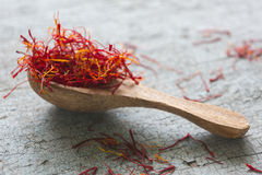 Spoon Of Saffron On Old Wooden Surface Stock Photography