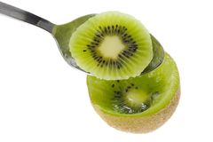 Spoon scooping kiwifruit Stock Photo