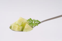 Spoon of sliced cucumber Stock Photo
