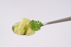 Spoon of sliced cucumber Royalty Free Stock Photo