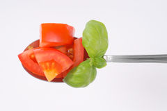 Spoon of sliced tomato Stock Images