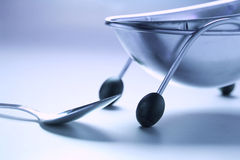 Spoon and Soup Bowl. In Blue Tone Stock Image