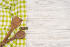 Spoon and spatula in the kitchen napkin and white table. Royalty Free Stock Photo