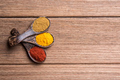 Spoon of spice. On the wooden table royalty free stock image